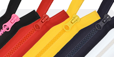 Moulded plastic zippers